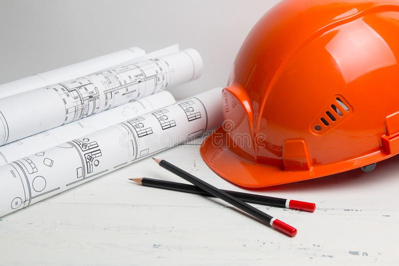 Architectural plan. Engineering house drawings, helmet, pencilsand blueprints royalty free stock photos