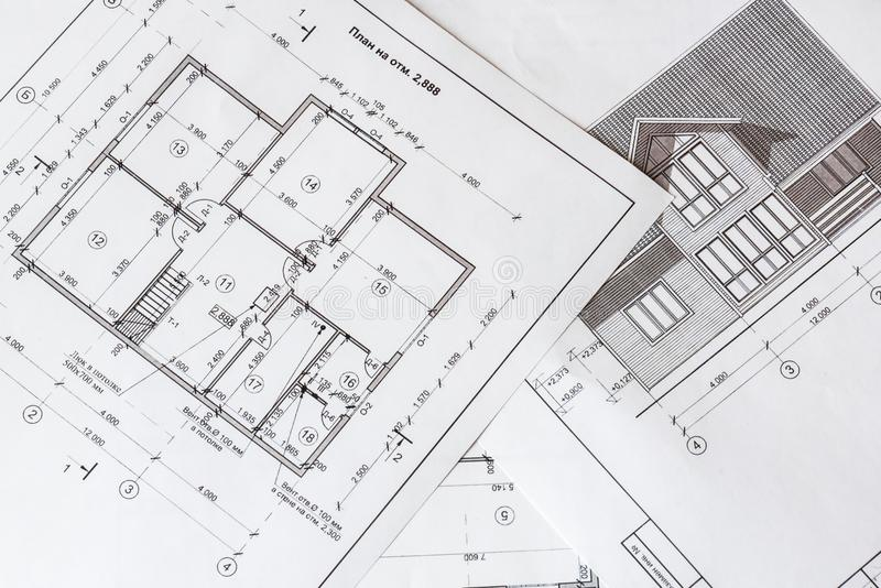 The architectural plan of the house is printed on a white sheet of paper. royalty free stock images