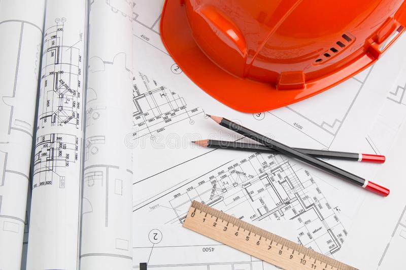 Architectural plan. Engineering house drawings, helmet, pencils and blueprints stock images