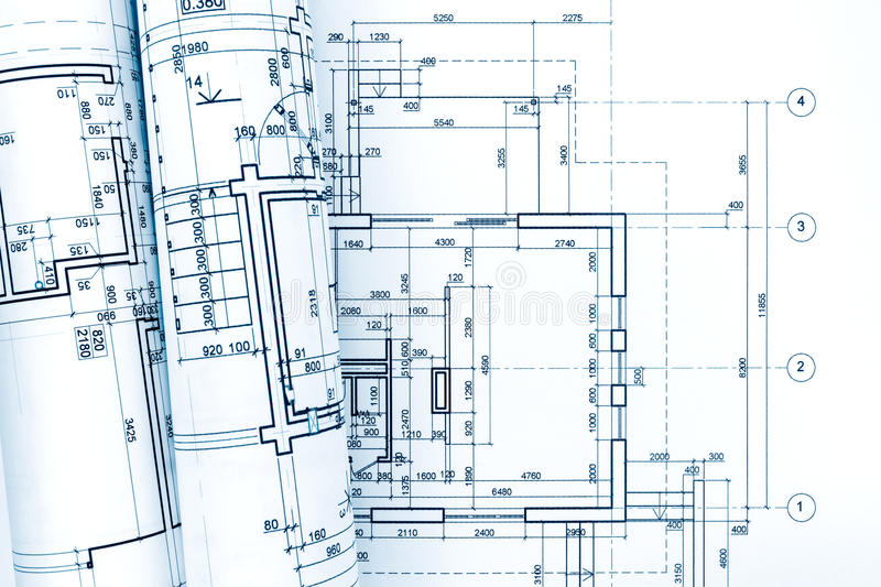 Architectural plan with rolled blueprints of house renovation stock image
