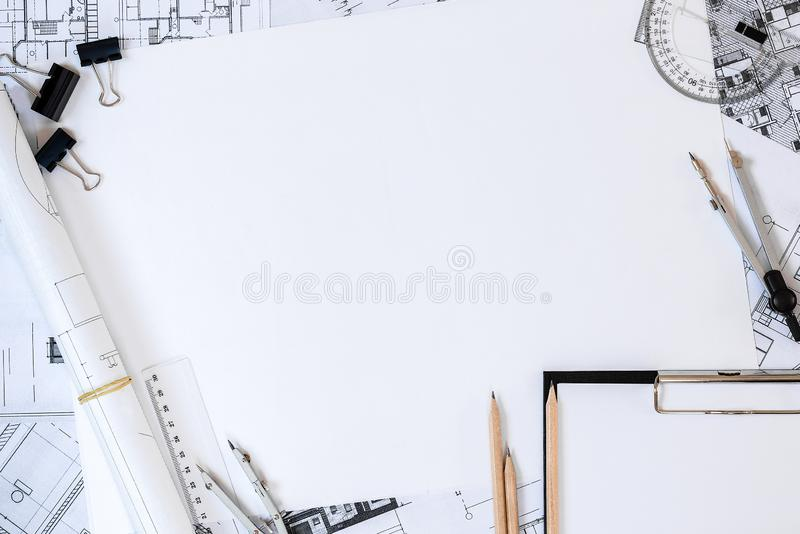 Architectural plans, pencil and ruler on the table. Place for your text. Architectural plans, pencil and ruler on a table. Office supplies in a workplace of the royalty free stock photography