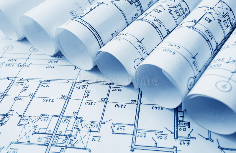 Architectural project, blueprints, blueprin. Architect workplace. Architectural project, blueprints, blueprint rolls on wooden desk table. Construction stock photos