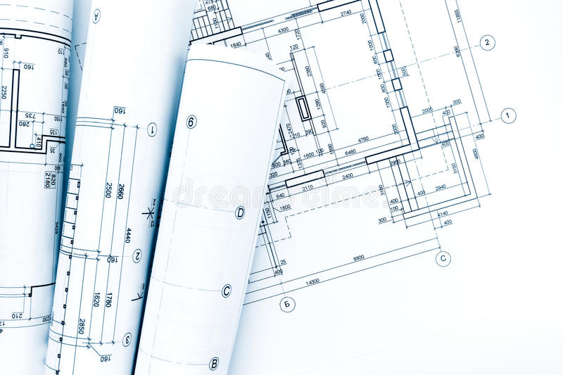 Architectural project, drawings, blueprint rolls on house plan stock photo