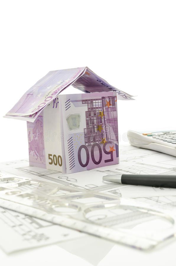 Architectural project with house made of money stock image