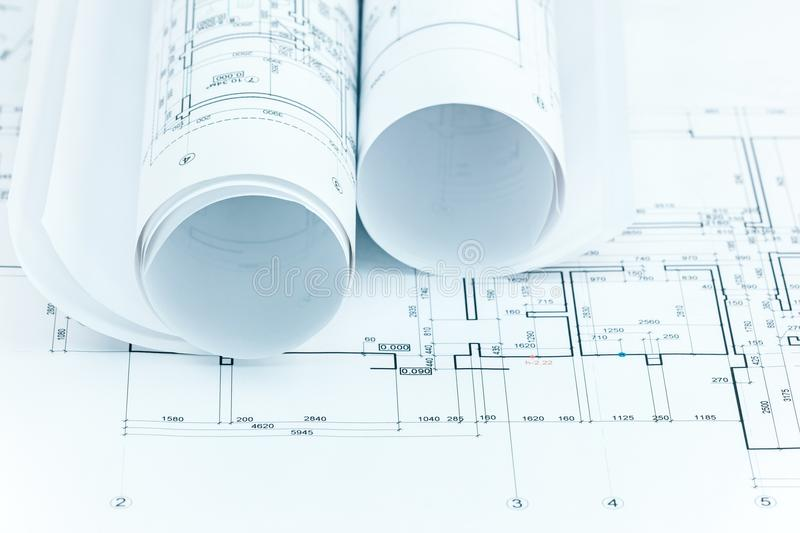 Architectural project plans and blueprint rolls for construction royalty free stock photo