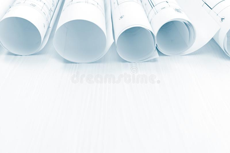 architectural project plans and blueprint rolls on white background stock photo