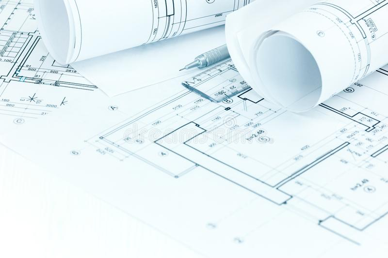 Architectural project plans and roll blueprints, pencil and rule stock photo