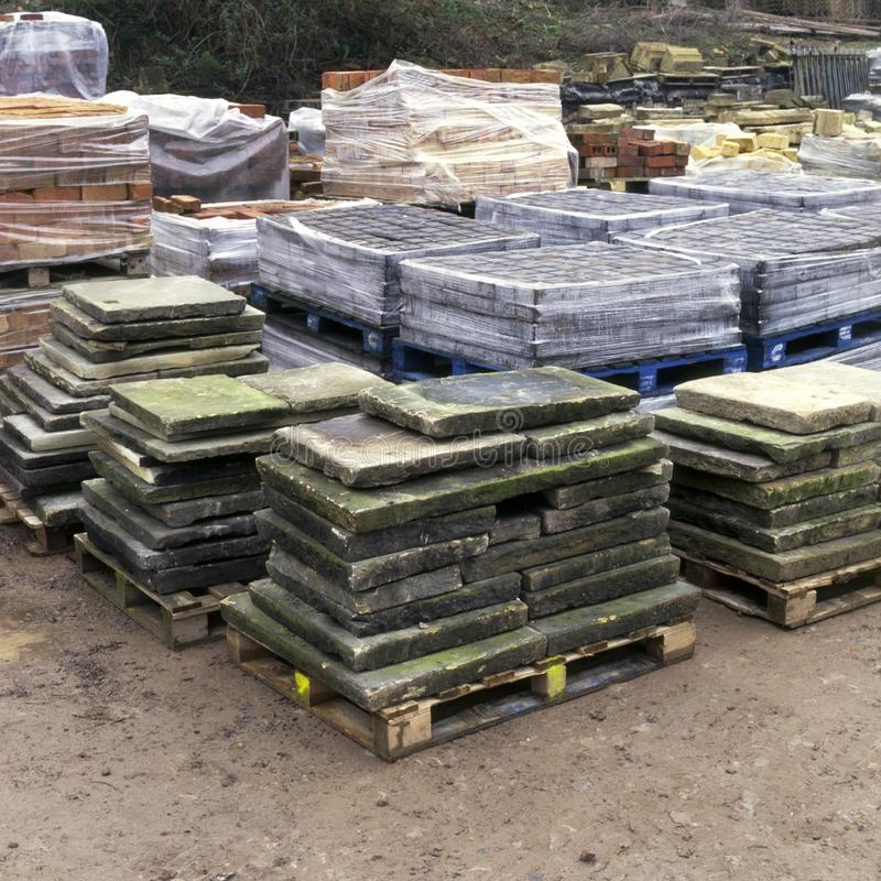 Architectural reclamation. Yard, paving slabs, stones and setts stock images