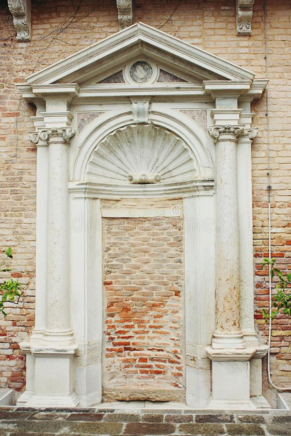 Architectural wall niche background. With ionic columns and pediment royalty free stock photos