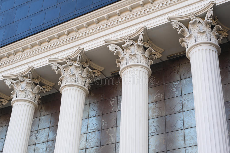 Architectural white Capital columns on the facade of the building.  stock photo