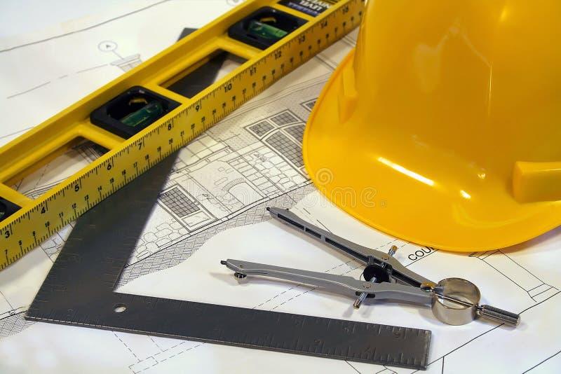 Architecturale plannen en hulpmiddelen stock afbeeldingen