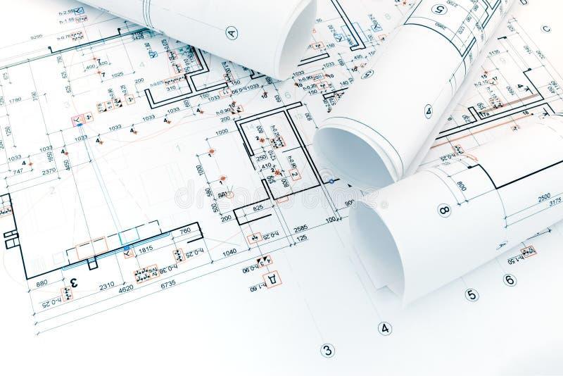 Architecturale projectplan en broodjes van blauwdrukken voor huisreno royalty-vrije stock afbeelding