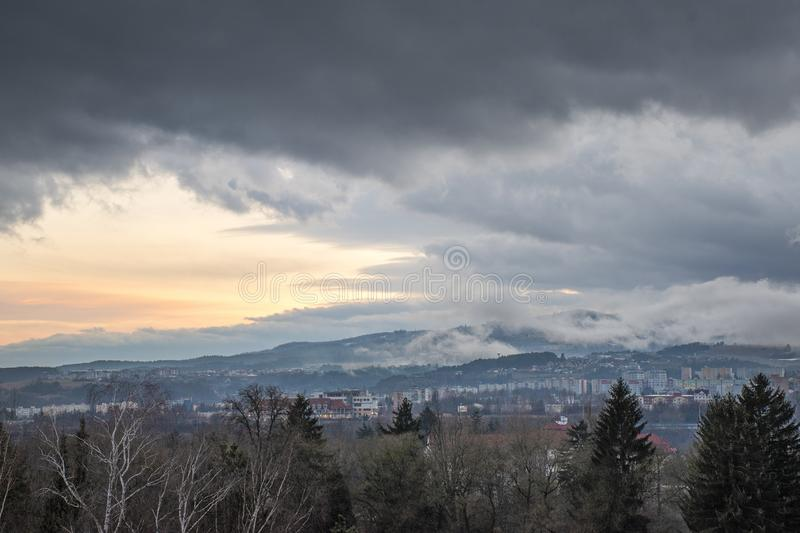 Beautiful dramatic sunset evening over town Banska Bystrica, Slovakia, Central Europe. Darkening sky. stock photos