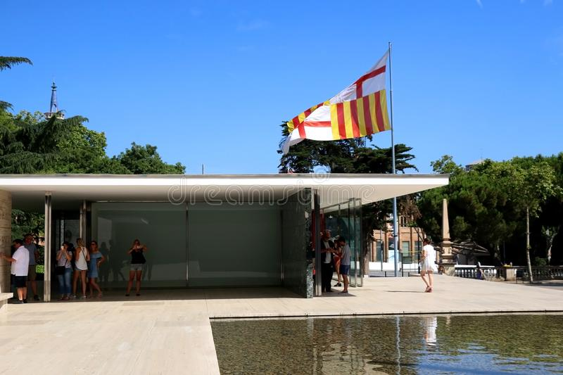 Architecture in Barcelona, Spain. Barcelona, Spain - July 8, 2018: Visitors at Barcelona Pavilion, designed by Ludwig Mies van der Rohe in Barcelona, Spain royalty free stock photography