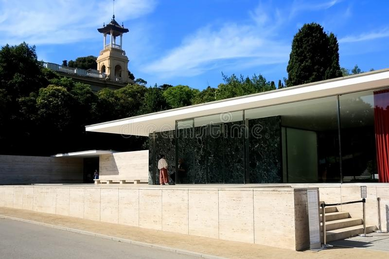 Architecture in Barcelona, Spain. Barcelona, Spain - July 8, 2018: Visitors at Barcelona Pavilion, designed by Ludwig Mies van der Rohe in Barcelona, Spain stock image