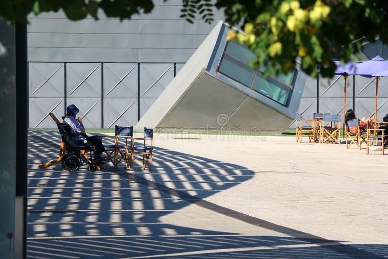 Architecture in Barcelona, Spain. Barcelona, Spain - July 7, 2018: Visitors relaxing at the garden of The Disseny Hub Barcelona, design museum in Barcelona royalty free stock images