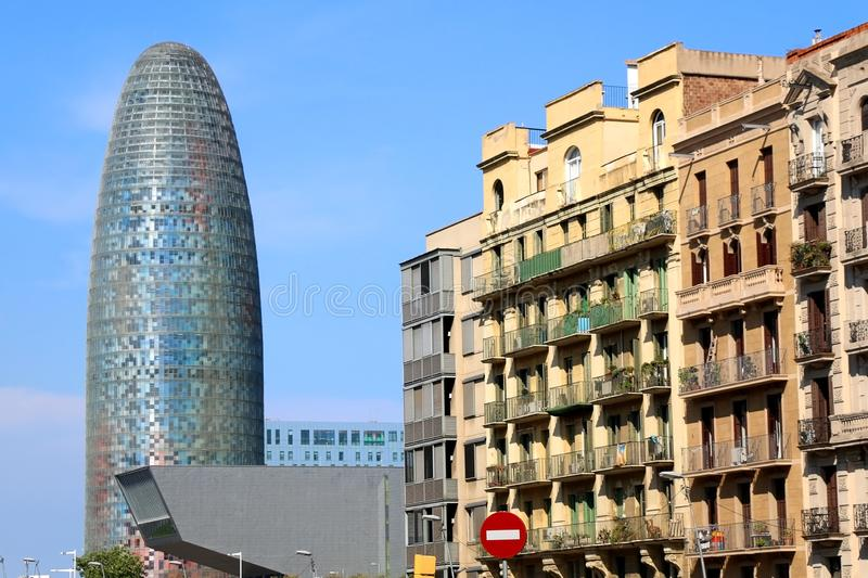 Architecture in Barcelona, Spain. Barcelona, Spain - July 7, 2018: The Disseny Hub Barcelona museum and the Torre Glories, formerly known as Torre Agbar stock photo
