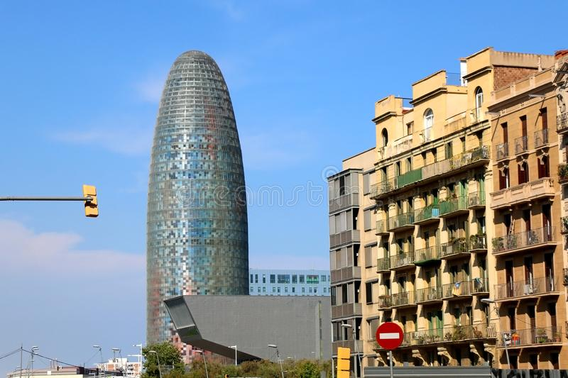 Architecture in Barcelona, Spain. Barcelona, Spain - July 7, 2018: The Disseny Hub Barcelona museum and the Torre Glories, formerly known as Torre Agbar stock images