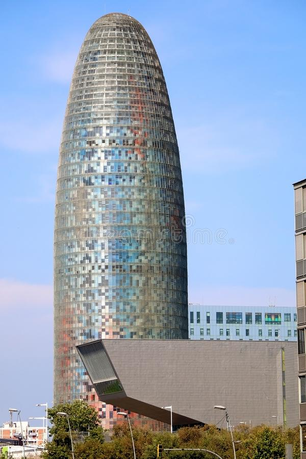 Architecture in Barcelona, Spain. Barcelona, Spain - July 7, 2018: The Disseny Hub Barcelona museum and the Torre Glories, formerly known as Torre Agbar stock photography