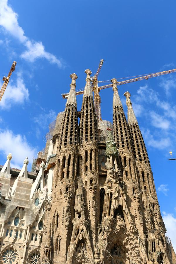Architecture in Barcelona, Spain. Barcelona, Spain - July 6, 2018: Nativity facade of Sagrada Familia - famous cathedral in Barcelona, Spain designed by Antoni stock images