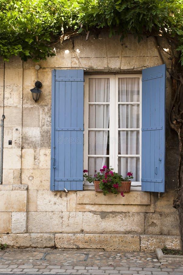 Architecture blue shutter Saint Jean de Cole royalty free stock photos