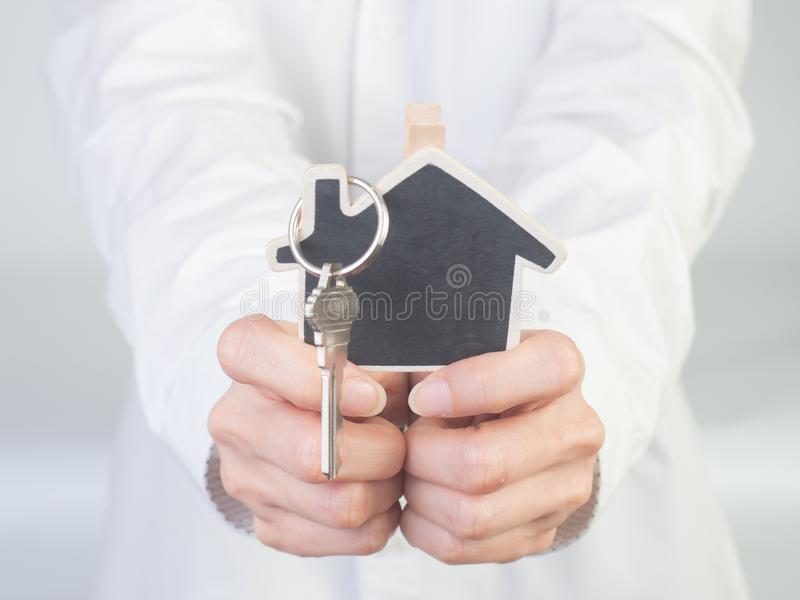 The Architecture, building, house,home,construction, real estate. And property concept - close up of hands holding house or home model.Female hand holding house stock photo