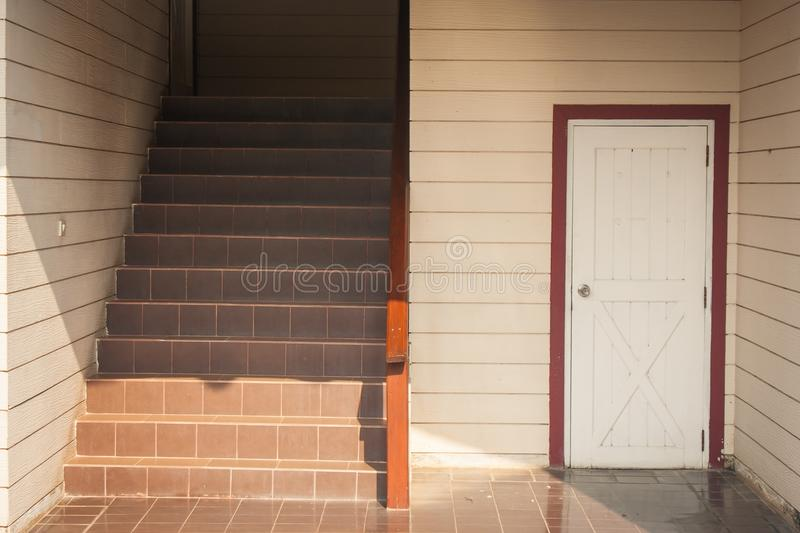 Architecture building interior design of staircase and white wooden door of room under stair. stock photography