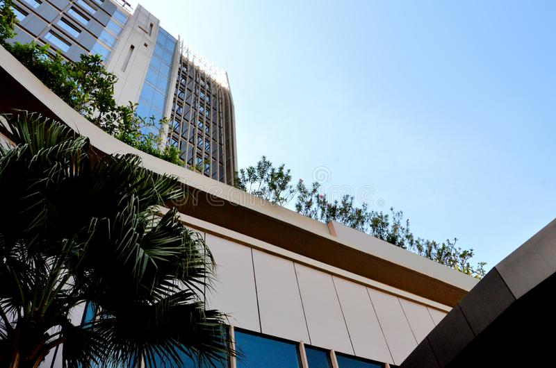 Architecture building reach the blue sky. Modern architecture hotel taken with diagonal composition frome above. Taken in Karawang, Indonesia royalty free stock image