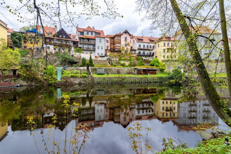Architecture of Cesky Krumlov reflected in Vltava river, Czech Republic royalty free stock image