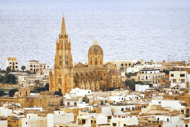Church in the middle of the city on the background of the sea stock image