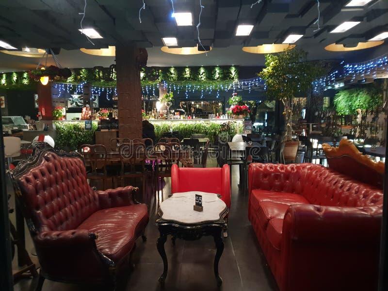 """Architecture design pub bar """"Milano""""  in milano italia italy  red leather couch. Architecture design pub bar milano italia italy leather royalty free stock image"""