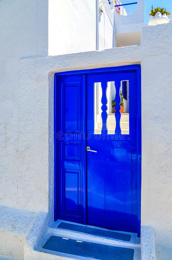 Architecture details of ancient building with blue door, Santorini island, Greece. Architecture details of ancient building. Traditional, vintage, wooden blue stock images