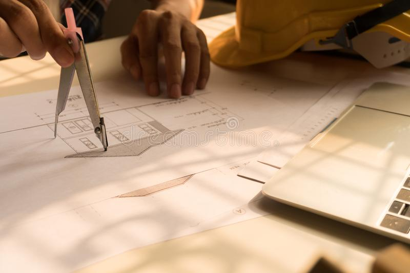 Architecture drawing plan on blue print with architect tools. On his workplace royalty free stock photography