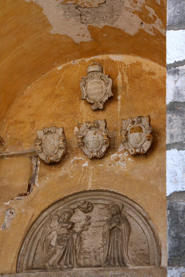 Architecture in Dubrovnik. Catholic relief and historic coats of arms on a building exterior in Dubrovnik, Croatia royalty free stock photo