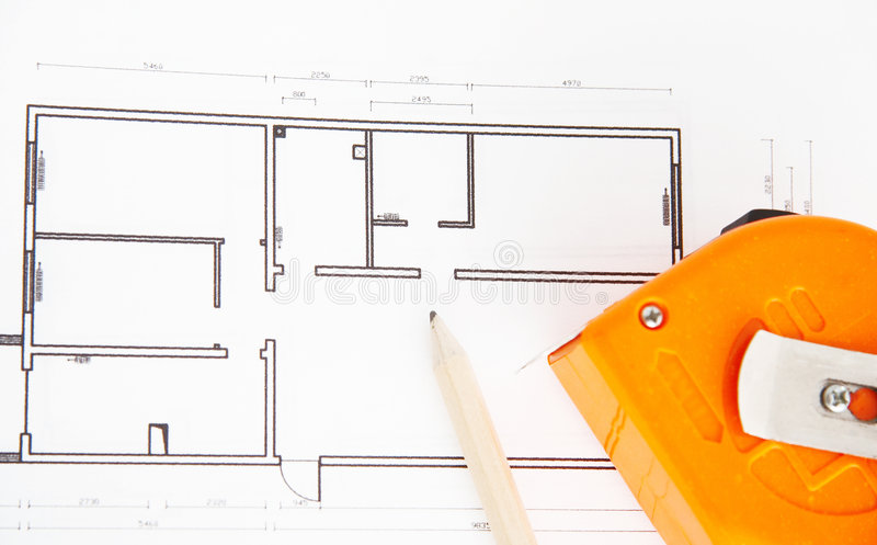Architecture floor plan. For a new house,pencil and tape measure on the plan royalty free stock images