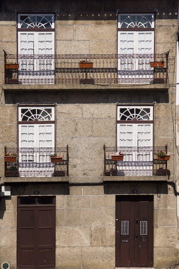 Architecture flowers Guimaraes Portugal. Faceds with flowers in Guimaraes Portugal stock photo