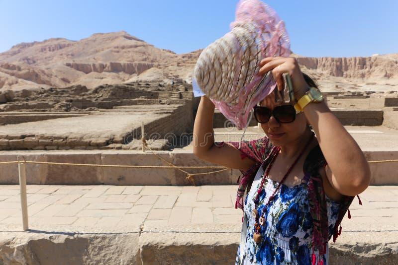 Egyptian woman at Karnak Temple at Luxor - Egypt. Architecture of Karnak Temple at Luxor - Egypt Karnak temple most huge temple at Egypt stock images