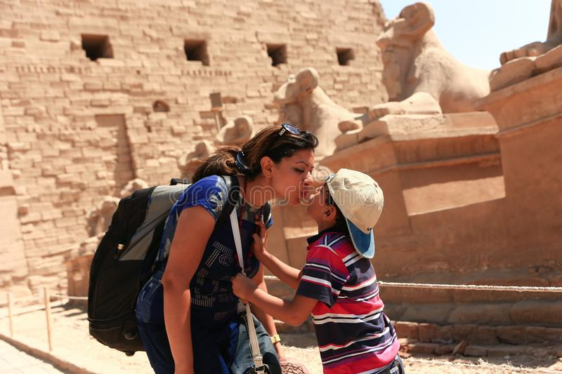 Mother kiss son at Karnak Temple - Egypt. Architecture of Karnak Temple at Luxor - Egypt Karnak temple - Most huge temple at Egypt stock photo