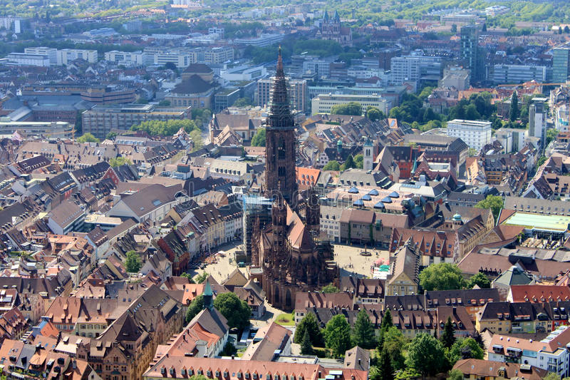Architecture, Minster church in Freiburg, Germany. This is a panorama picture which include the old minster church in Freiburg, Germany royalty free stock images