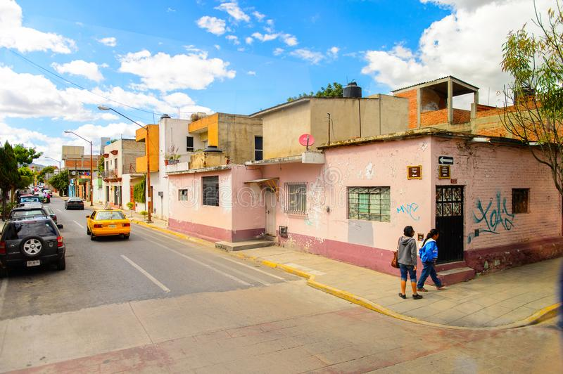 Architecture of Oaxaca. OAXACA, MEXICO - OCT 31, 2016: Small colored houses on the typical street of Oaxaca de Juarez, Mexico. The name of the town is derived royalty free stock images