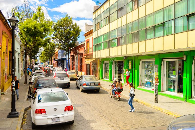 Architecture of Oaxaca. OAXACA, MEXICO - OCT 31, 2016: Small colorful houses on the typical street of Oaxaca de Juarez, Mexico. The name of the town is derived royalty free stock image