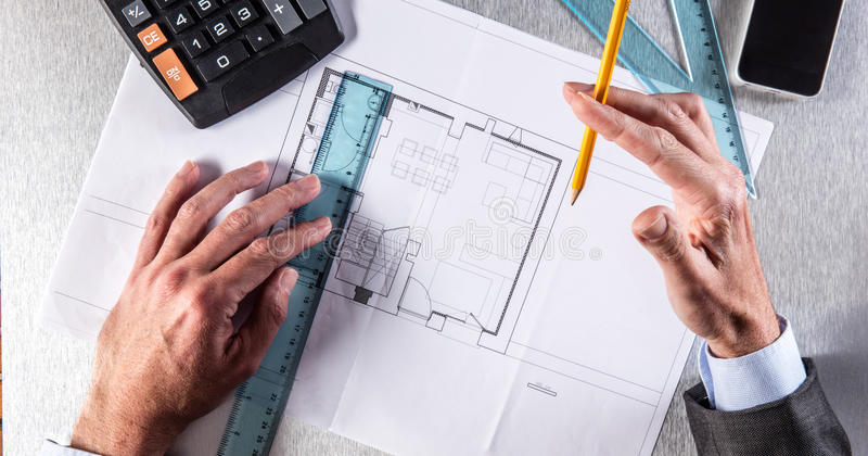Architecture professional hands drawing on blue print for property concept stock photos