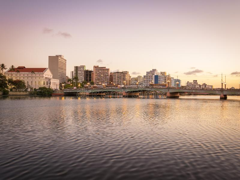 Recife in PE, Brazil. The architecture of Recife in PE, Brazil with its 17th century buildings mixed with contemporary ones at sunset by the Capibaribe River stock photography