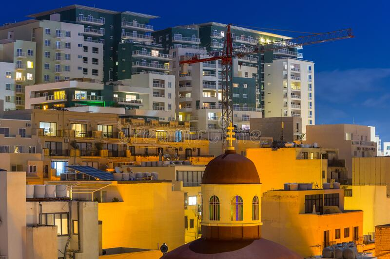 Architecture of the residential area in Sliema at night, Malta royalty free stock photo