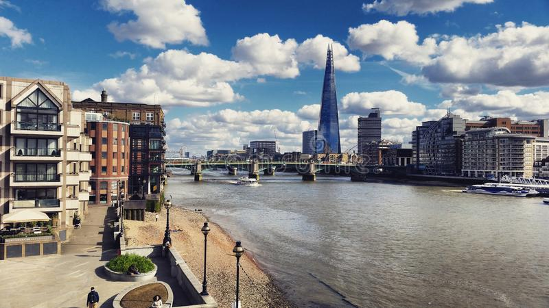 Architecture by the river. Southwark Bridge. The Shard. London royalty free stock photography