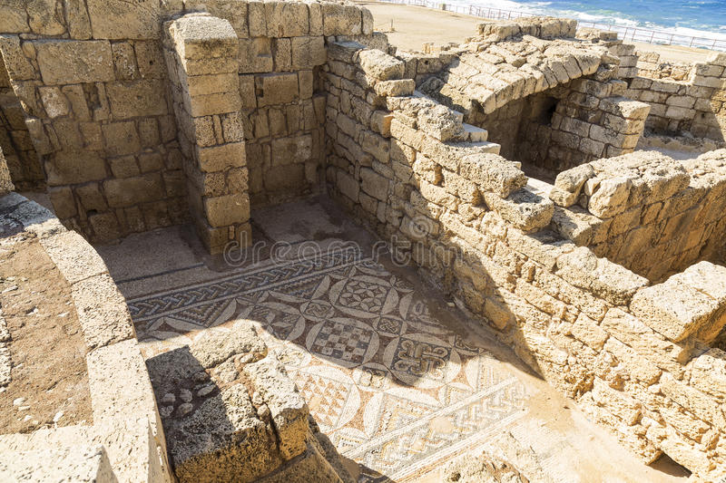 The architecture of the Roman period in the national park Caesarea on the Mediterranean coast of Israel. Preserved fragment of Roman mosaics on the floor stock photo