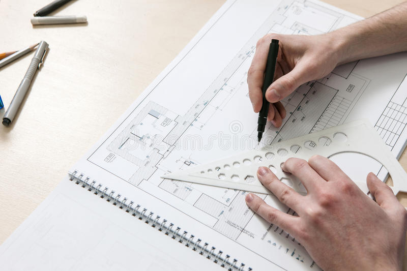 Architecture scheme with hands drawing royalty free stock photos