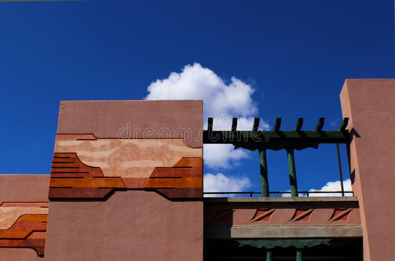 Architecture with southwestern design in stucco against blue sky with clouds, Santa Fe, New Mexico royalty free stock image