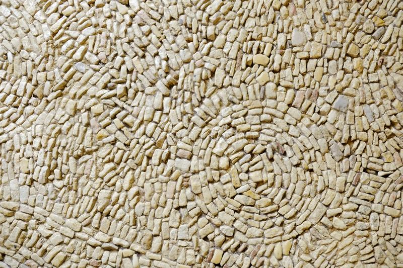 Architecture texture -flooring. Small stone chippings set in a vague circle pattern to create outdoor paving stock images