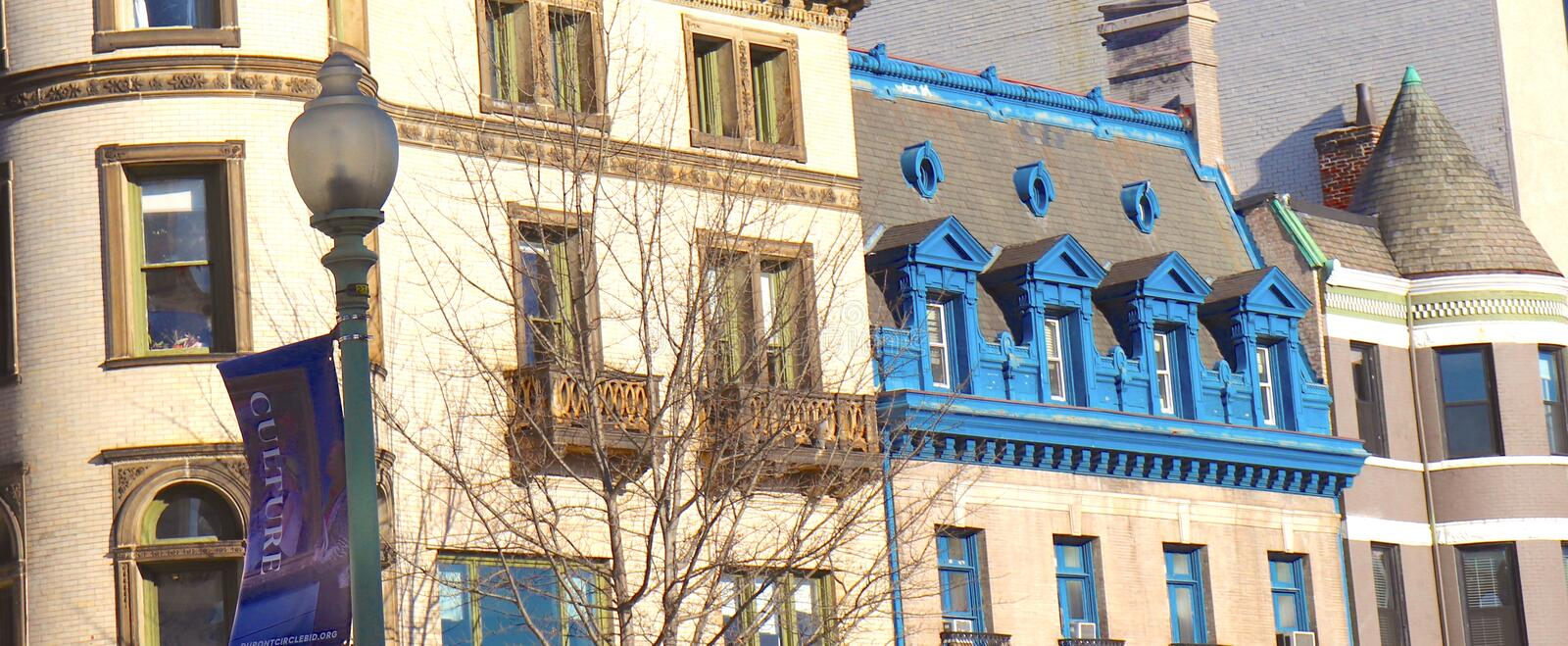 Blue Trimmed Balconies on Historic Buildings. Architecture wins the medal in this partial view of a city block in Washington DC with a sign declaring Culture royalty free stock photos